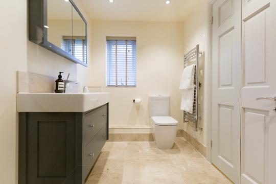 Honed marble en suite bathroom design installation for Bathroom design surrey